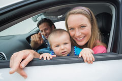 Parents and baby on a drive Royalty Free Stock Photo