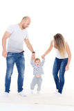Parents with baby. First steps. Royalty Free Stock Image