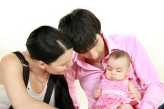 Parents with baby girl over white Royalty Free Stock Images
