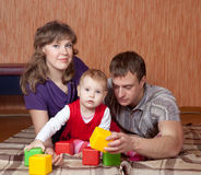 Parents with baby in home Stock Photos