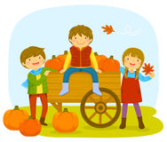 Parents and a baby. Kids in a pumpkin patch with a cart of pumpkins during autumn Royalty Free Stock Images
