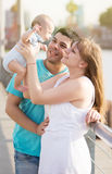 Parents with baby in park Stock Images