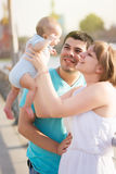 Parents with baby in park Stock Photo