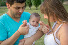 Parents with baby in park Royalty Free Stock Image