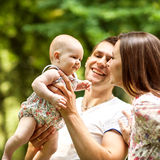 Parents with baby in park Royalty Free Stock Images