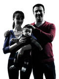 Parents with baby portrait silhouette stock photos