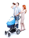 Parents with baby pram, father drinking alcohol Stock Image