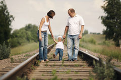 Parents with baby on railroad Stock Photos