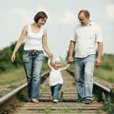Parents with baby on railroad Stock Images