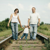 Parents with baby on railroad Royalty Free Stock Photos