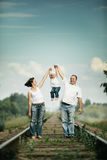 Parents with baby on railroad Royalty Free Stock Image