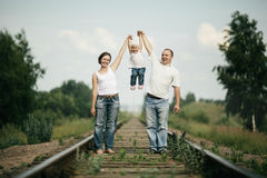 Parents with baby on railroad Stock Photo