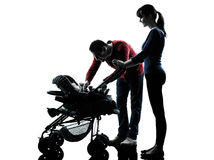 Parents with baby silhouette Stock Image