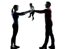 Parents with baby silhouette Stock Photos