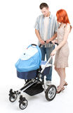 Parents with baby stroller Stock Image