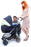 Parents with baby stroller Stock Photography