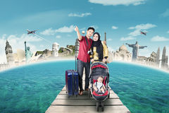 Parents with baby travelling to the world monuments Stock Photography