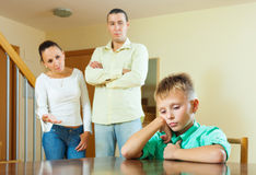 Parents berates her teenage child in interior Royalty Free Stock Photos