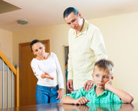Parents berating her teenage child. In interior. Focus on boy only Stock Images