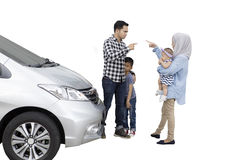 Parents blaming each other in front of car Royalty Free Stock Photography