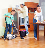 Parents and  boy cleaning  in  room Royalty Free Stock Photography