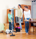 Parents and  boy cleaning together Royalty Free Stock Photography