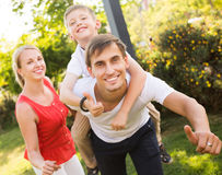Parents with boy having fun Stock Photos