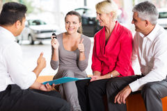 Parents buying car for daughter Royalty Free Stock Images