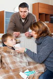 Parents caring for unwell boy Royalty Free Stock Image