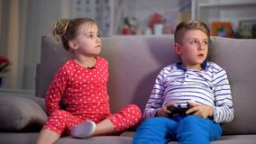 Parents catching children playing game at night, discipline control, behavior. Stock photo royalty free stock photo