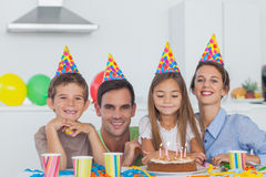 Parents celebrating their daughter birthday Royalty Free Stock Photo