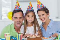 Parents celebrating their little girls birthday Stock Photo