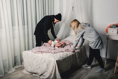 parents change the little baby on the bed royalty free stock photography