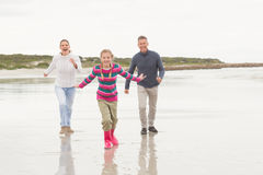 Parents chasing their kid for fun Stock Image