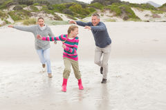 Parents chasing their kid for fun Royalty Free Stock Photos