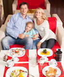 Parents with child in cafe Stock Images