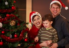 Parents and child at christmas Royalty Free Stock Images