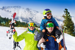 Parents and child on dad's shoulders in ski masks Royalty Free Stock Photo