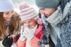 Parents and child drink tea. As family in winter royalty free stock photos