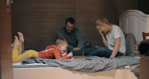 Family having funny chess game in bedroom stock footage