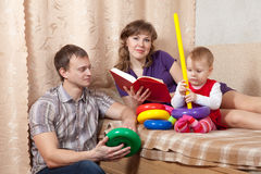 Parents with  child in home Stock Photos