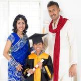 Parents and child on kinder graduate day. Kindergarten graduation. Asian Indian family, parents and child on kinder graduate day Royalty Free Stock Photos