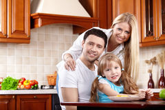 Parents with the child on kitchen Stock Photography