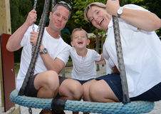 Parents with child at the playground Stock Image