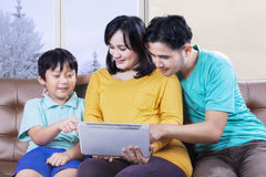 Parents and child pointing tab screen Royalty Free Stock Image