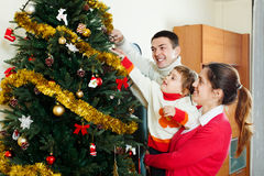 Parents and child  preparing for Christmas Stock Image