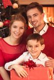 Parents and child with present stock photography