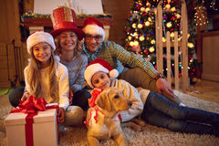 Parents and child with present for Christmas Royalty Free Stock Photos