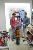 Parents with child in shop Stock Images