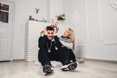 parents with the child sit on the floor and play and have fun stock images